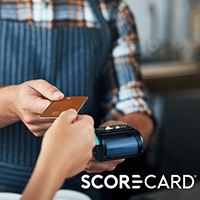 ScoreCard Rewards - Shopper and merchant with POS machine