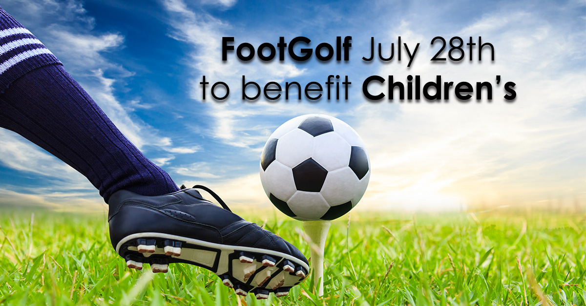 Foot about to kick a soccer ball on a golf tee.  FootGolf July 28th to benefit Children's