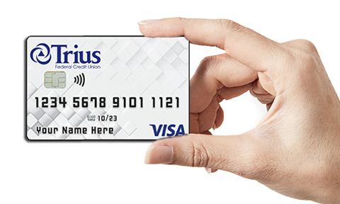 Trius Visa card held by a hand