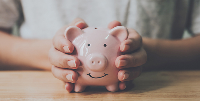 Piggy bank held by hands