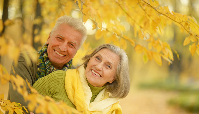 Older couple with yellow leaves